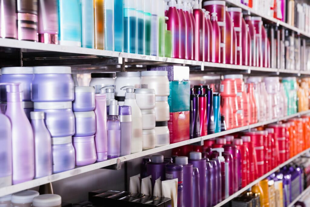 Image of shelves with conditioners and mousses for hair in the store.