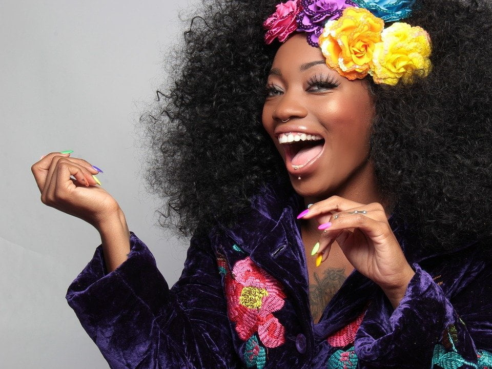 afro woman shrink hair smiling