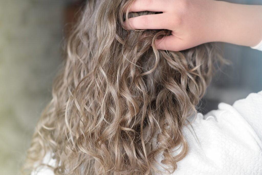 Curly, blond, gel